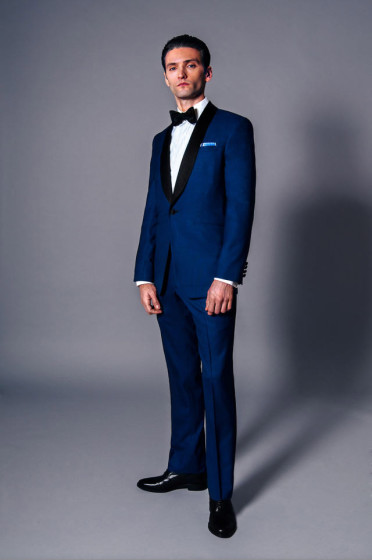 Groom wearing a custom tuxedo with shawl collar