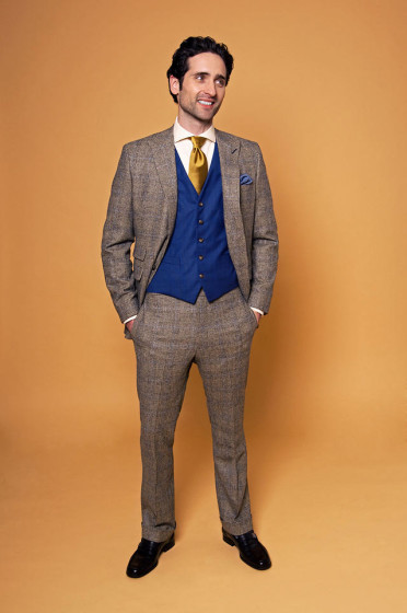 Traditional suit with blue vest and gold tie