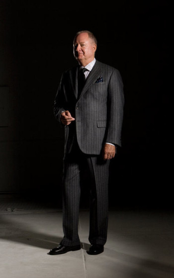 Man in grey stripe suit